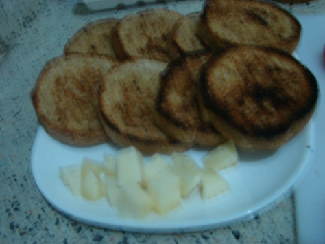 toasted bread slices and mozzarella cheese pieces